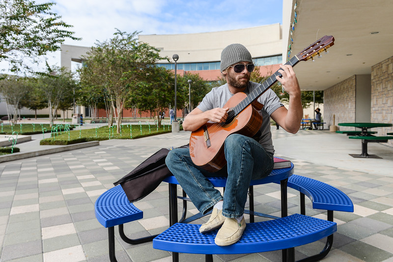 Student Beau Declarcq, warms up before his Music History class, in Lee Plaza.