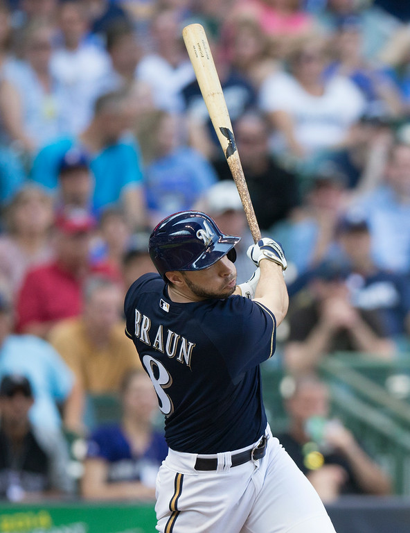 . Ryan Braun of the Milwaukee Brewers\' hits a two RBI triple off of Charlie Blackmon of the Colorado Rockies\' during the fifth inning of a baseball game Saturday, June 28, 2014, in Milwaukee. (AP Photo/Tom Lynn)