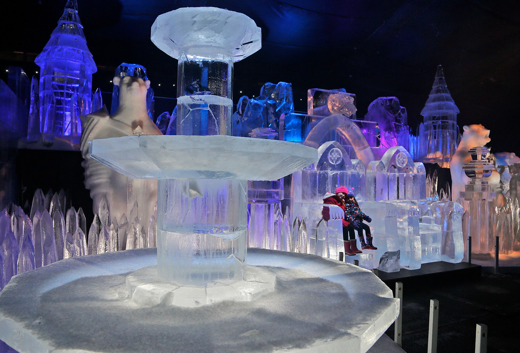 . Scarlett, 4-years-old points left, and Zoe 3-years-old enjoy sitting on a Throne of the castle ice sculpture at the launch of Hyde Park Winter Wonderland\'s Magical Ice Kingdom in London, Thursday, Nov. 17, 2016. This years Winter Wonderland starts on November 18,2016 and lasts until January 2, 2017. (AP Photo/Frank Augstein)