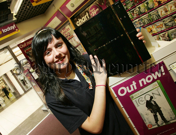 Frankie Bannon a sales assistant from GAME is pictured with the Playstation 3 which went on sale on Friday last. 07W13N11