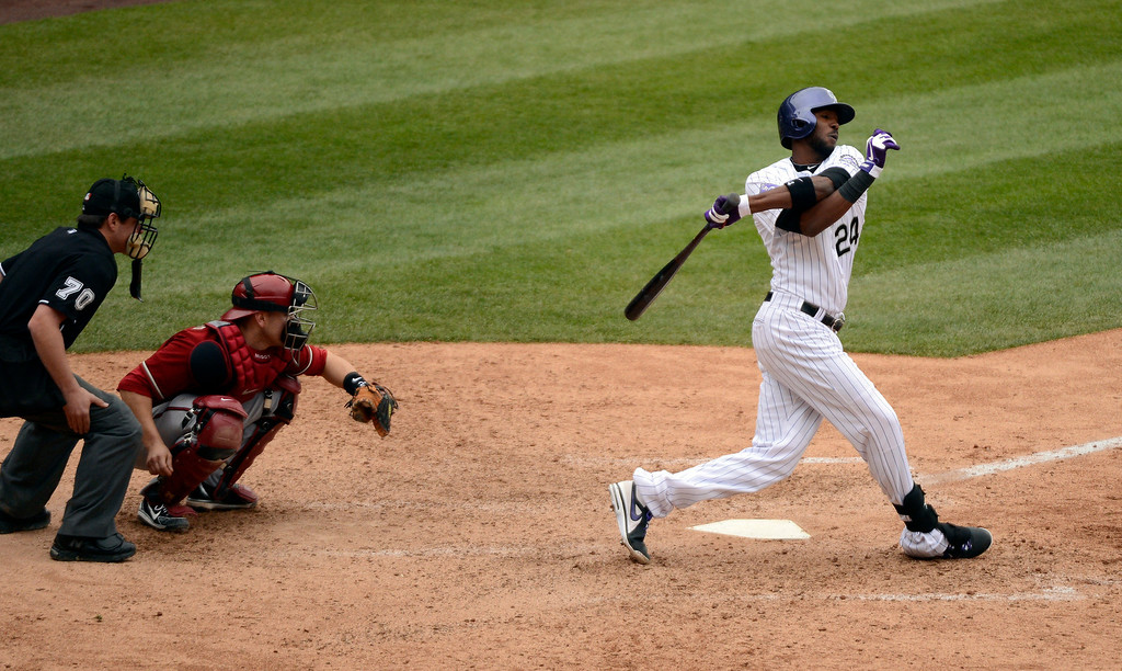 . DENVER, CO. - APRIL 21: Dexter Fowler (24) of the Colorado Rockies gets all twisted after swing at a pitch by Heath Bell of the Arizona Diamondbacks in the ninth inning April 21, 2013 at Coors Field. (Photo By John Leyba/The Denver Post)