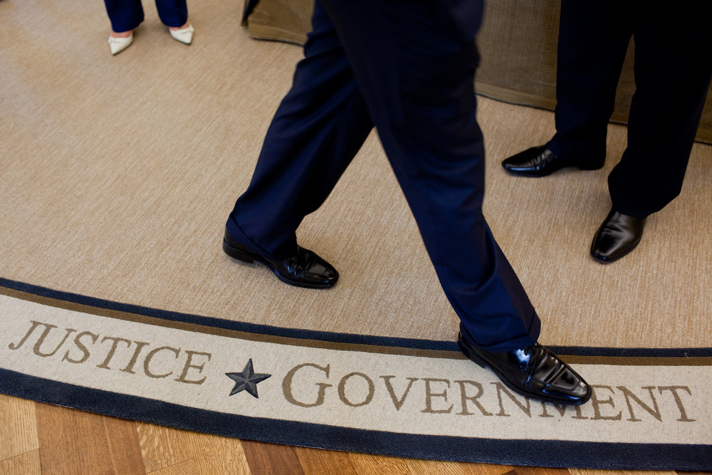 ". Sept. 1, 2010 ""Halfway through his second year, the President finally got his own Oval Office rug (he had been using President Bush\'s). The new rug includes several famous quotations, and I tried to frame people\'s feet by some of the words in the quotations.\"" (Official White House Photo by Pete Souza)"
