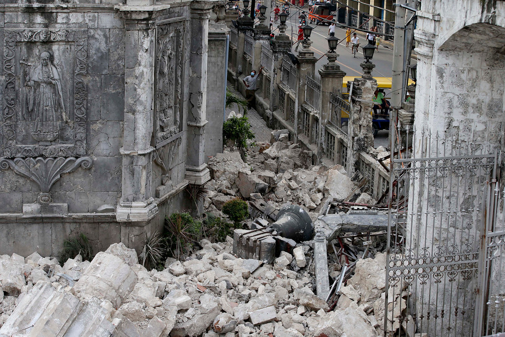 . The bell of Basilica of the Holy Child lies amidst the rubble following a 7.2-magnitude earthquake that hit Cebu city in central Philippines and toppled the bell tower of the Philippines\' oldest church Tuesday, Oct. 15, 2013.  (AP Photo/Bullit Marquez)