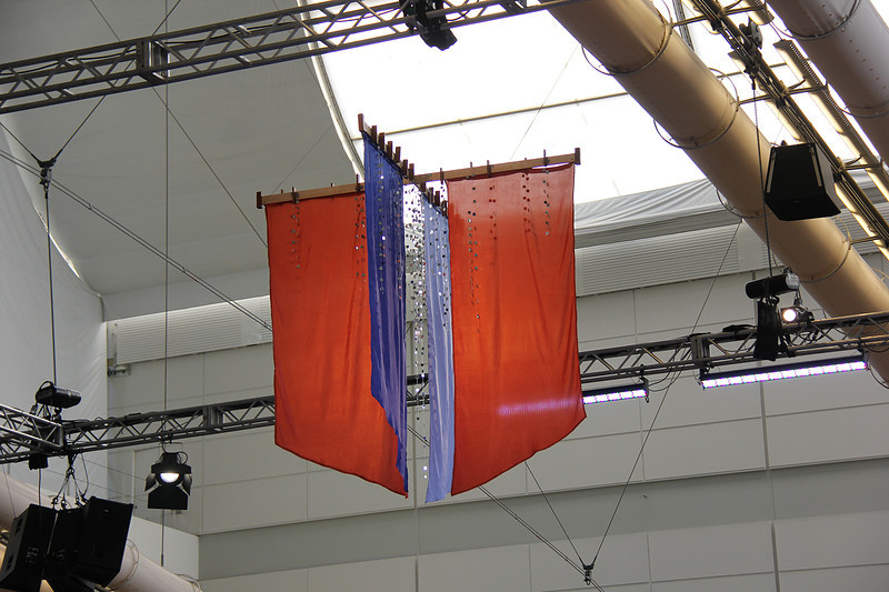 A banner hangs from the ceiling of the worship space.