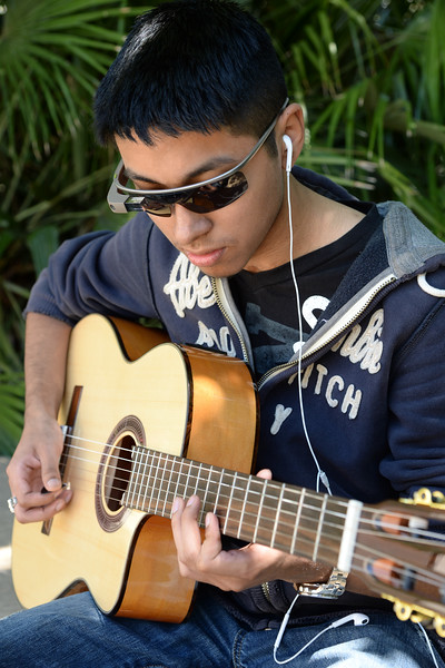 a-student-takes-a-break-to-enjoy-the-weather-and-some-music_13896178183_o.jpg