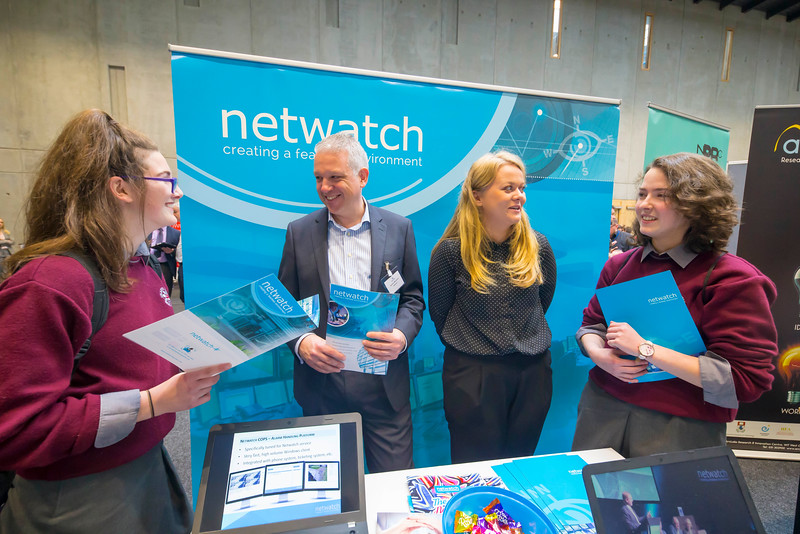 "09/11/2017. Crystal Valley Tech Showcase at WIT Arena. Pictured are Alex Sheehan and Sophie Lye, students from St Declan's Secondary School with Declan Mcgrane and Keeva McCormack of Netwatch. Picture: Patrick Browne  Event demonstrates Tech and ICT is thriving in Waterford and the South East 50 companies and 2,000 students, industry and recruiters attend the inaugural Crystal Valley Tech Showcase event  Over 50 companies who are working together as Crystal Valley Tech showcased their rapidly growing industry in the WIT Arena on Thursday morning to approx. 2,000 members of the public, college and second level students, recruiters, government agencies and other industry.  The future is bright for ICT in the South East according to Dr Padraig Kirwan, Head of the Department of Computing & Mathematics at Waterford Institute of Technology. ""Computing is thriving in the South East judging by the number and diversity of ICT companies here today. Even more encouraging is the number of second level students who attended from Waterford, Kilkenny, Carlow, Tipperary and Wexford and how interested they are about the career opportunities in this exciting industry.""  Waterford schools attending the event included the Presentation Secondary School, St Angela's Secondary School, St Paul's Community College, and the Waterford College of Further Education from Water city, St Declan's Community College in Kilmacthomas, and Colaiste Chathail Naofa in Dungarvan.  Elaine Fennelly, Bluefin Payment Systems General Manager and co-founder of Crystal Valley Tech is very excited about the industry in the South East and today's showcase event. ""People who work in the industry already know that Tech is well established in the South East and the number of opportunities and companies continues to grow and grow. According to a recent Tech Ireland report there are over 60 indigenous and multinational companies employing well over 1,500 people from their bases in Waterford, Wexford, Kilk"