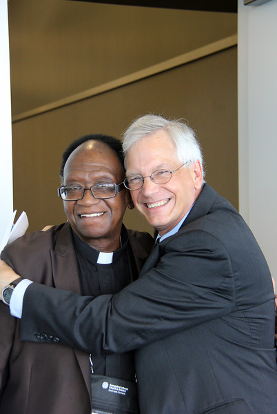 David Swartling, secretary of the ELCA, hugs the Rev. Walter May.