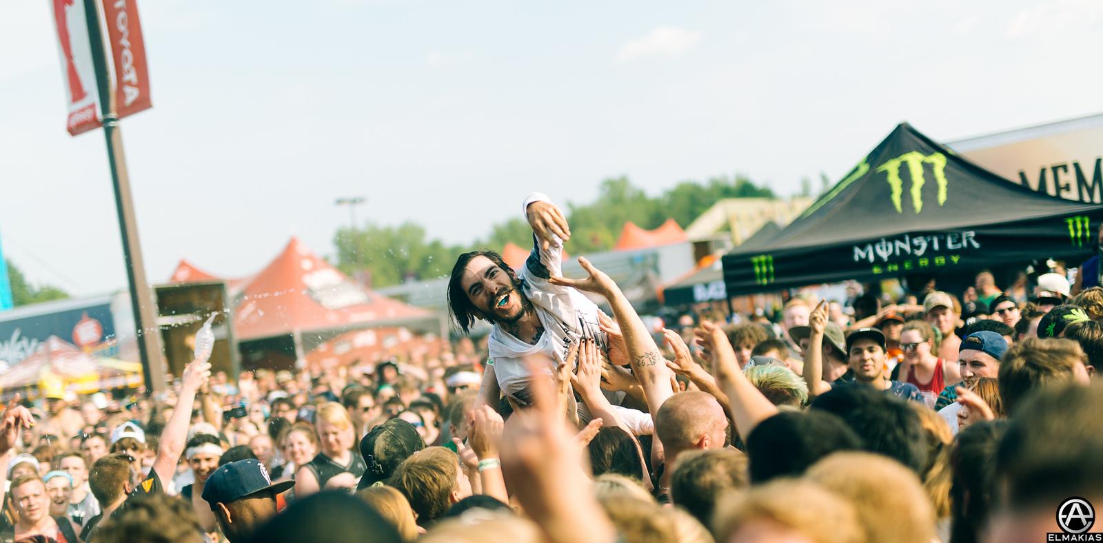Carlos Navarro crowdsurfing during Beartooth live at Vans Warped Tour 2015 by Adam Elmakias