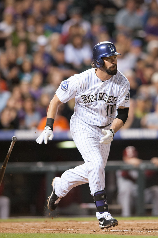 . DENVER, CO - SEPTEMBER 20:  Todd Helton #17 of the Colorado Rockies doubles in the sixth inning of a game against the Arizona Diamondbacks at Coors Field on September 20, 2013 in Denver, Colorado. (Photo by Dustin Bradford/Getty Images)