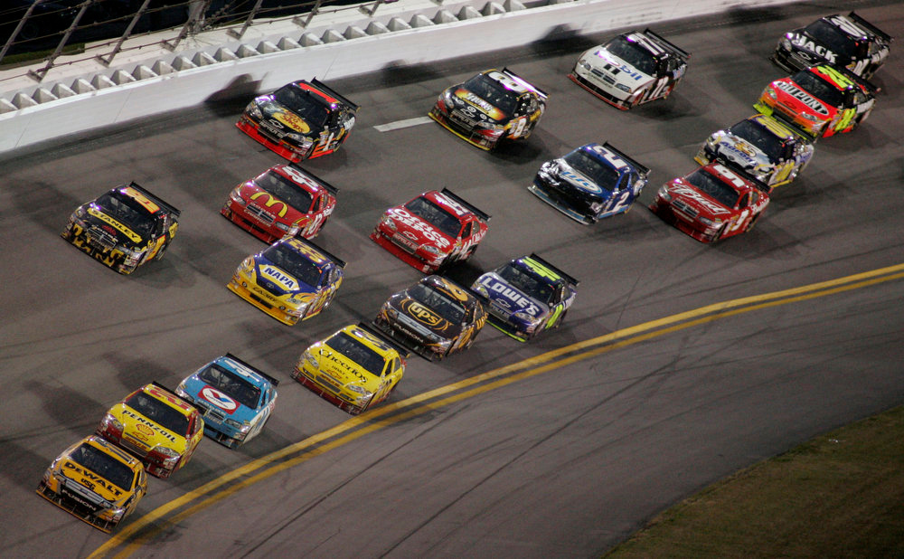 . Matt Kenseth (17) leads Kevin Harvick (29) and the rest of the field in the late laps of the rain-shortened NASCAR Daytona 500 auto race at Daytona International Speedway in Daytona Beach, Fla., Sunday, Feb. 15, 2009. Kenseth won the race, and Harvick was second. (AP Photo/Jim Topper)