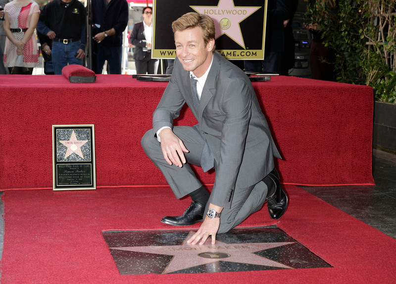 . Australian actor Simon Baker poses with his newly unveiled star on the Hollywood Walk of Fame February 14, 2013.  REUTERS/Fred Prouser