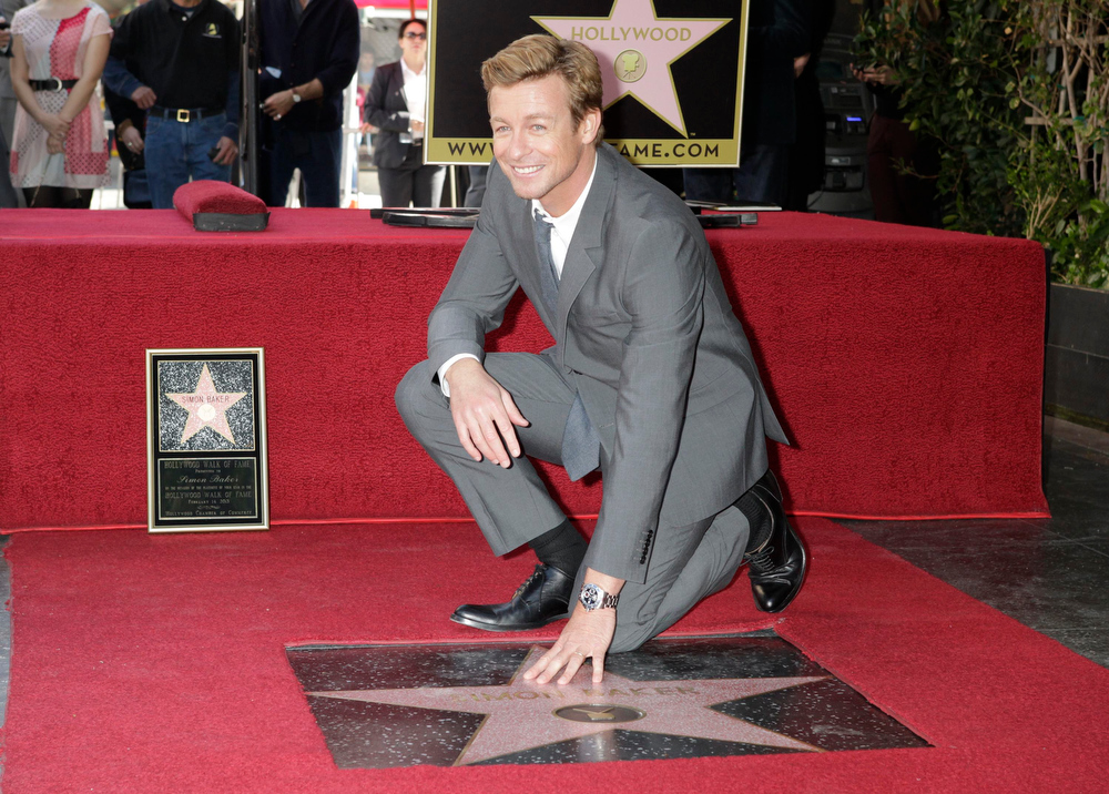 Description of . Australian actor Simon Baker poses with his newly unveiled star on the Hollywood Walk of Fame February 14, 2013.  REUTERS/Fred Prouser