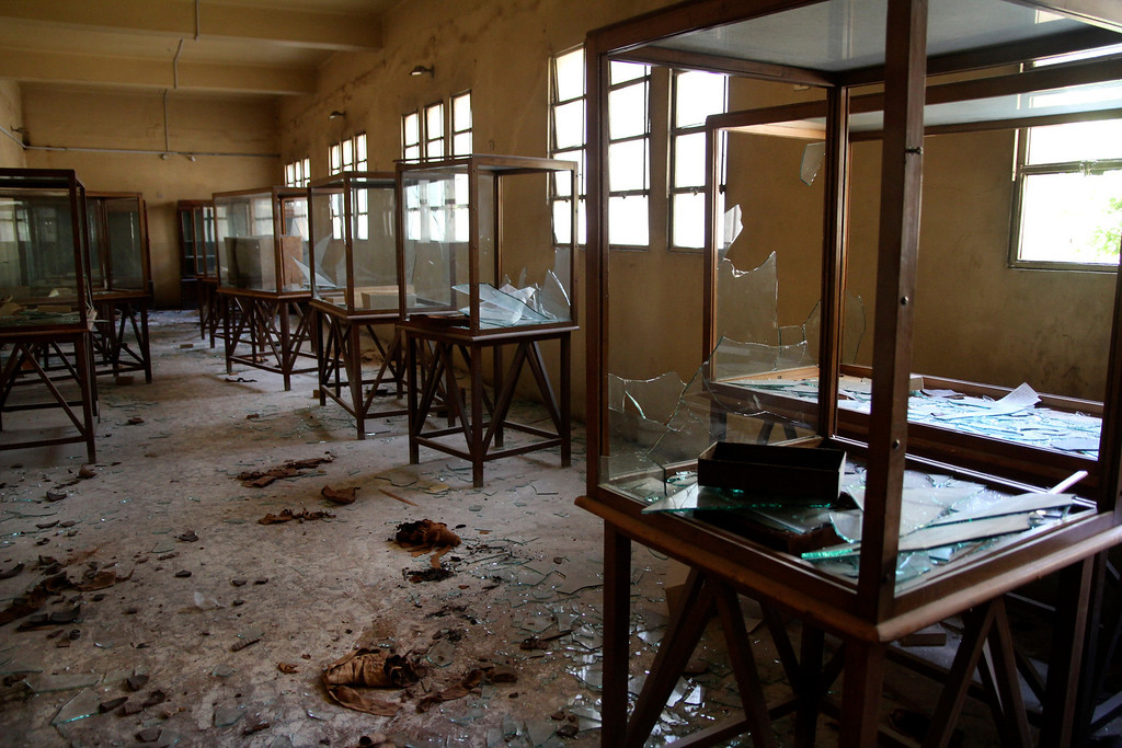 . Rows of display cases are broken and empty at the Malawi Antiquities Museum after it was ransacked and looted between the evening of Thursday, Aug. 15 and the morning of Friday, Aug. 16, 2013 in Malawi, south of Minya, Egypt, Saturday, Aug. 17, 2013. The interim Cabinet authorized police to use deadly force against anyone targeting police and state institutions on Thursday. The violence capped off a week that saw more than 700 people killed across the country. (AP Photo/Roger Anis, El Shorouk Newspaper)