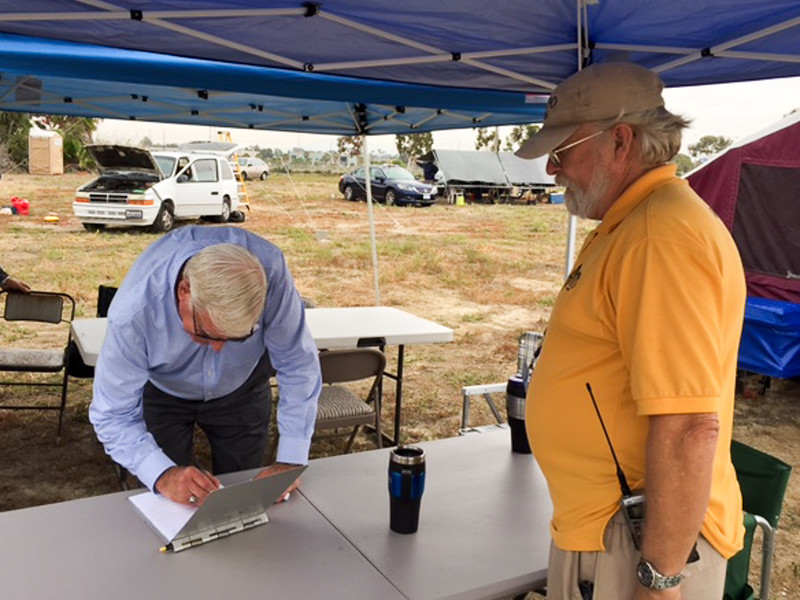 County Supervisor Greg Cox signes the guest roster whil SOBARS President, John Wright looks on.