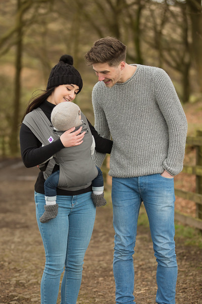 Izmi_Baby_Carrier_Mid_Grey_Lifestyle_Front_Carry_Walking_In_Woods_Looking_At_Baby.jpg