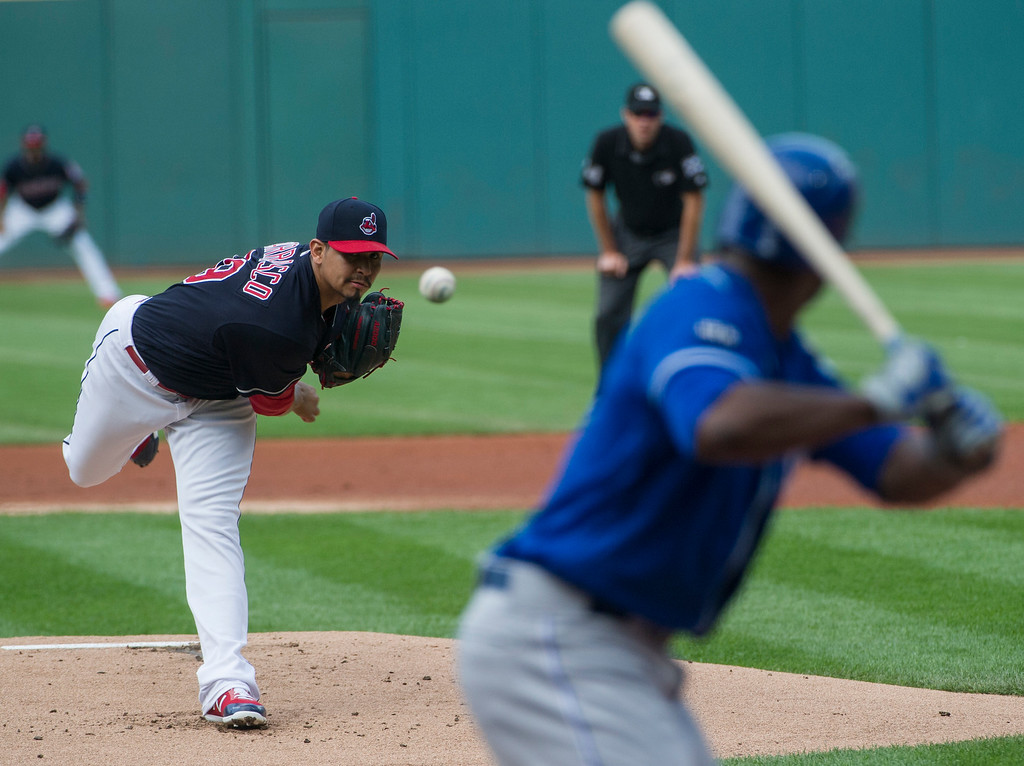 . Cleveland Indians starting pitcher Carlos Carrasco delivers to Kansas City Royals\' Lorenzo Cain during the first inning of a baseball game in Cleveland, Saturday, Sept. 16, 2017. (AP Photo/Phil Long)