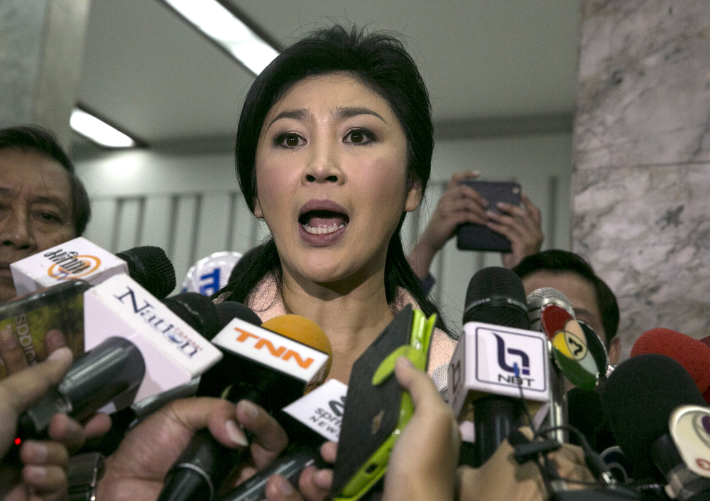 . Caretaker Prime Minister of Thailand Yingluck Shinawatra speaks to the media after a meeting with her cabinet amid continuing anti-government protests on January 21, 2014 in Bangkok, Thailand. Starting tomorrow, the Thai government will impose a 60-day state of emergency in Bangkok and the surrounding provinces, in an attempt to cope with the on-going political turmoil. (Photo by Paula Bronstein/Getty Images)