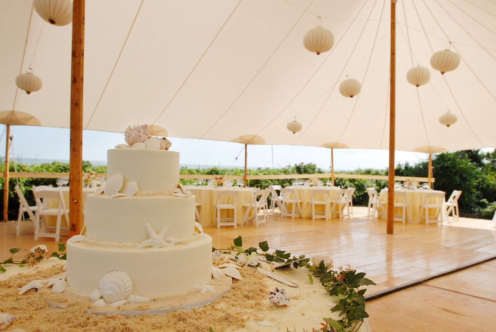 Seashell wedding cake at a waterfront Cape Cod reception site. Photo by Bello Photography - Home - The Casual Gourmet, Cape Cod Wedding Caterer
