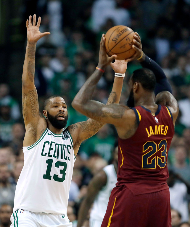 . Boston Celtics forward Marcus Morris (13) defends Cleveland Cavaliers forward LeBron James (23) during the second half in Game 2 of the NBA basketball Eastern Conference finals, Tuesday, May 15, 2018, in Boston. (AP Photo/Charles Krupa)