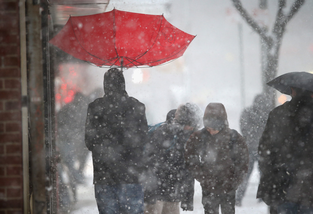 . A person walks with an upturned umbrella during a snowstorm on February 13, 2014 in New York City. Heavy snow and high winds made for a hard morning commute in the city.  (Photo by John Moore/Getty Images)