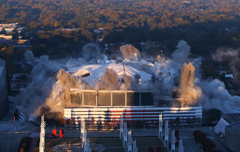 . The Georgia Dome is imploded Monday, Nov. 20, 2017, in Atlanta. The Dome was the home of the Atlanta Falcons, hosted two Super Bowls and the 1996 Summer Olympic Games. (AP Photo/John Bazemore)