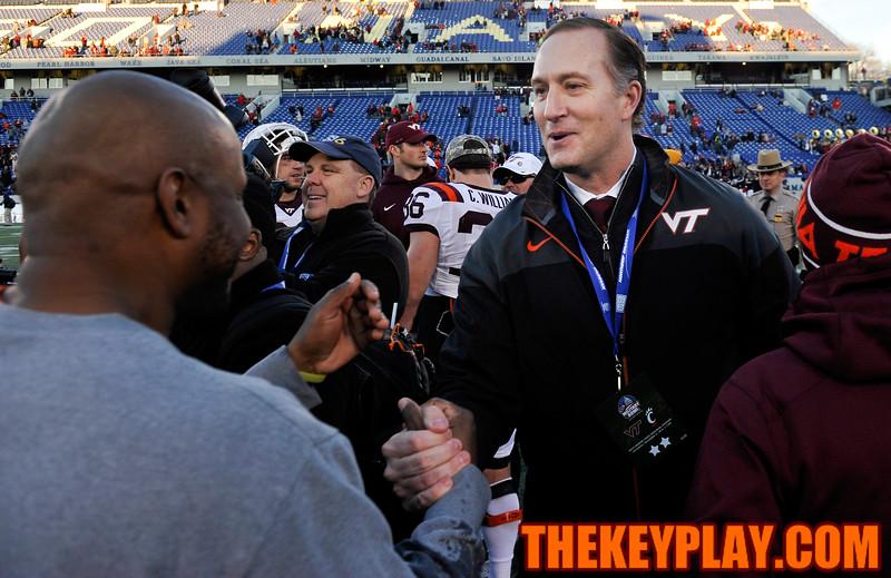 Virginia Tech Hokies Athletic Director Whit Babcock congratulates Deputy Director of Football Operations Bruce Garnes following the victory. (Michael Shroyer/TheKeyPlay.com)