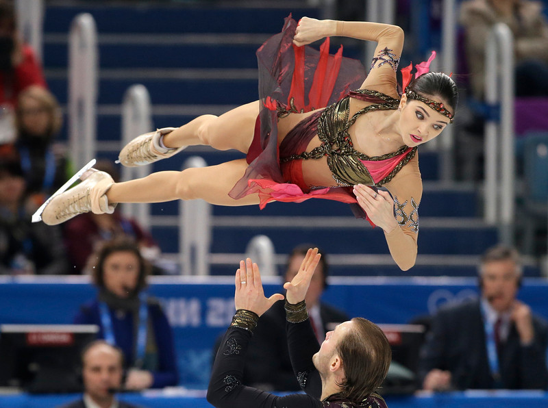 . Vera Bazarova and Yuri Larionov of Russia compete in the pairs free skate figure skating competition at the Iceberg Skating Palace during the 2014 Winter Olympics, Wednesday, Feb. 12, 2014, in Sochi, Russia. (AP Photo/Darron Cummings)