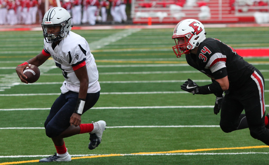. Randy Meyers - The Morning Journal<br> Lorain quarterback Jordan Jackson runs free past Elyria linebacker Michael Knapp for a second quarter touchdown on Sept. 8.