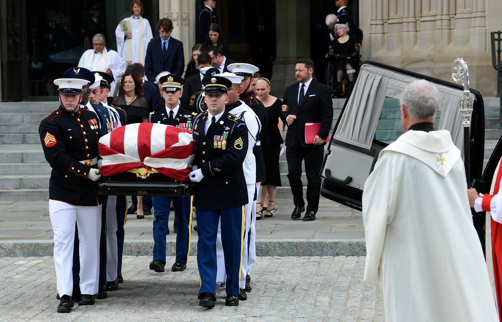 . The casket of Sen. John McCain, R-Ariz., followed by family members, is carried out of Washington National Cathedral in Washington , Saturday, Sept. 1, 2018, following a memorial service. McCain died Aug. 25 from brain cancer at age 81. (AP Photo/Susan Walsh)