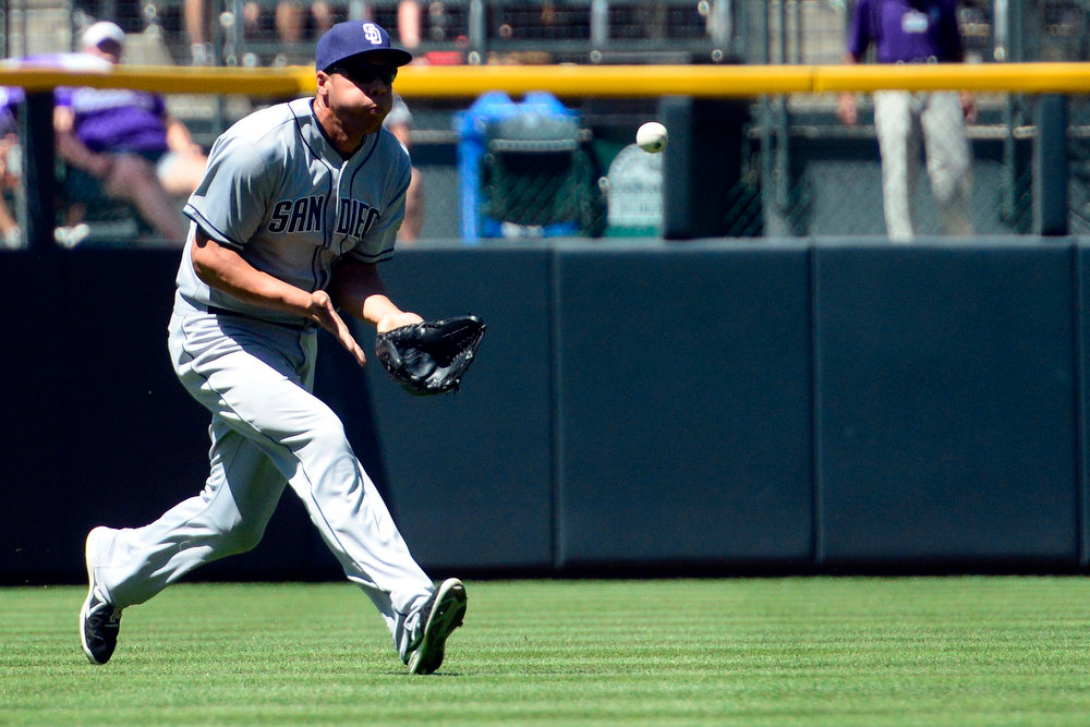 . San Diego Padres right fielder Kyle Blanks (88) makes a catch during the action in Denver. Blanks threw out Colorado Rockies first baseman Todd Helton (17) on the play as he attempted to tag from third and score. The Colorado Rockies hosted the San Diego Padres at Coors Field on Sunday, June 9, 2013. (Photo by AAron Ontiveroz/The Denver Post)