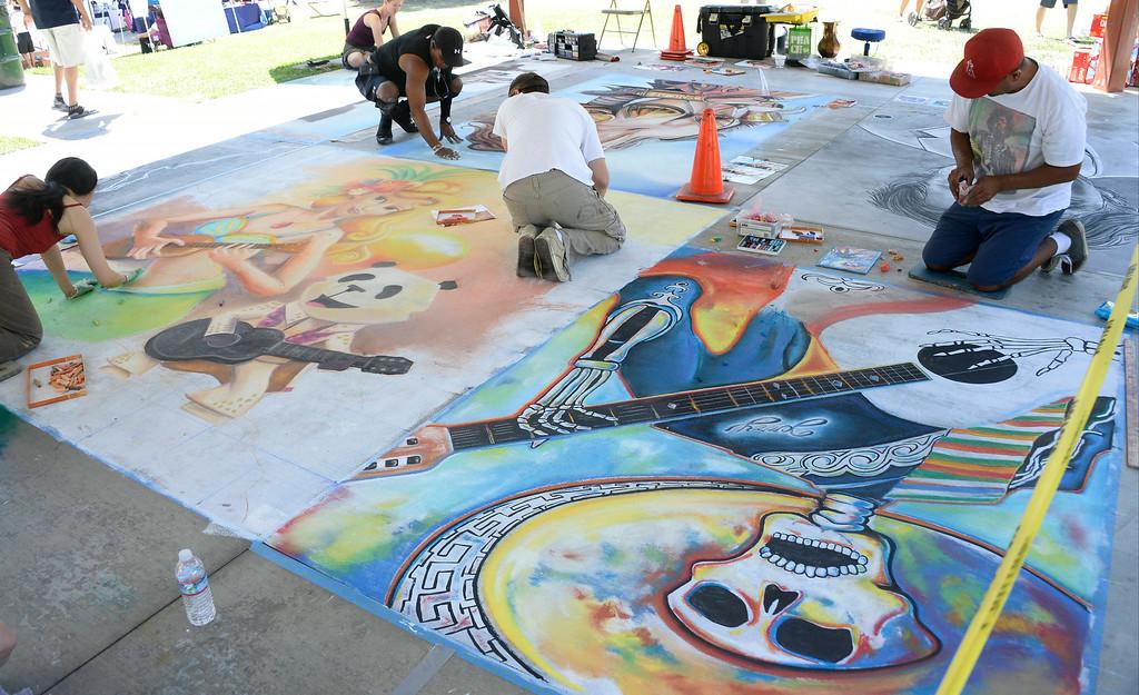 . Aug 31,2014, sylmar CA. Chalk Artist\'s  works on their art during the 2014 Sylmar Olive Festival.  Photo by Gene Blevins/LA DailyNews