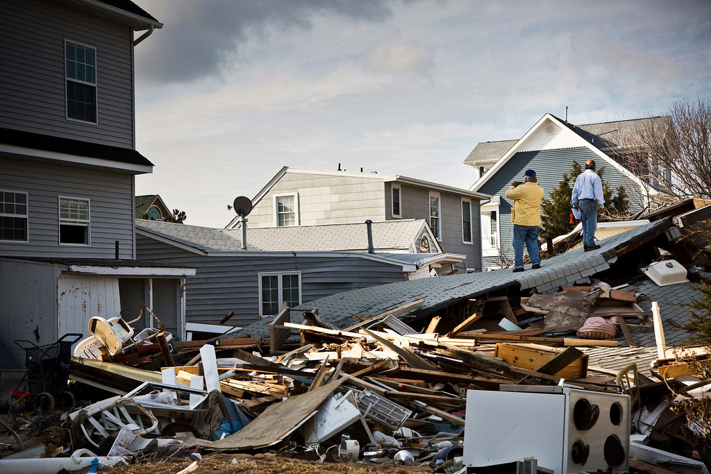 . Men survey damage caused by Hurricane Sandy in the Ortley Beach area of Toms River, New Jersey November 28, 2012. The storm made landfall along the New Jersey coastline on October 29. REUTERS/Andrew Burton OCIETY)