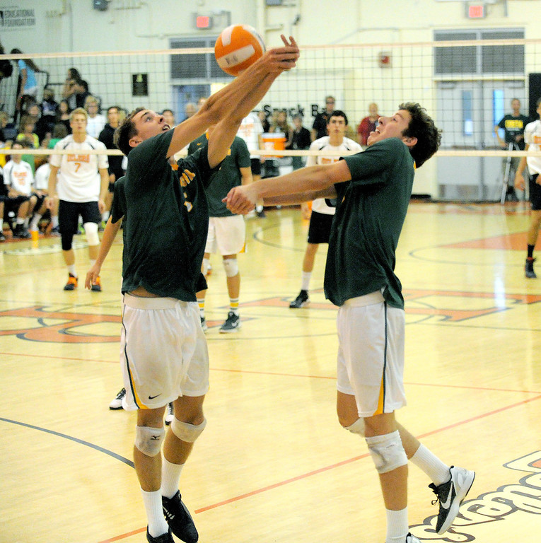 . 05-15-2013-( Daily Breeze Staff Photo by Sean Hiller) Huntington Beach swept Mira Costa in Wednesday\'s  boys volleyball CIF Southern Section Division I semifinal at Huntington Beach High School. Costa\'s Riley Mallon, left, and Casey White try and keep the ball in play.