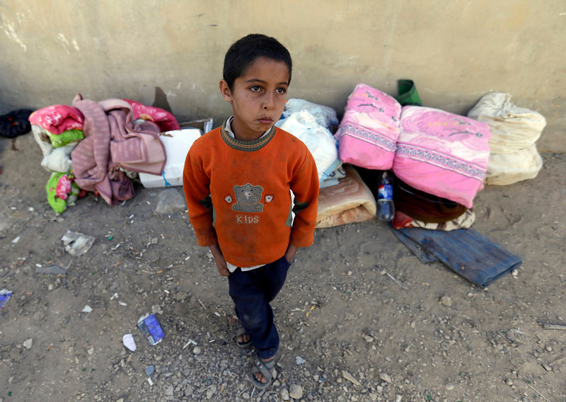 . Suleiman, 8, a Syrian boy who fled to Lebanon this morning with his family from the town of Qusair after it fell to Syrian forces loyal to President Bashar Assad and Hezbollah fighters, stands in front of his belongings, in Arsal town, near the Lebanese-Syrian border, Wednesday, June 5, 2013. The Syrian army captured a strategic town near the Lebanese border on Wednesday after a grueling three-week battle, handing a heavy defeat to rebels and solidifying a shift in the country\'s civil war in favor of President Bashar Assad\'s regime.(AP Photo/Hussein Malla)