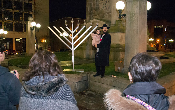 12/26/19 Wesley Bunnell | StaffrrRabbi Yosef Rivkin holds his daughter Chana, age 3, on Thursday December 26, 2019 during a Menorah lighting in Central Park.