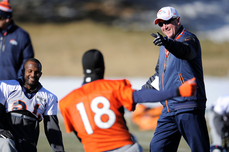 . Denver Broncos head coach John Fox smiles as he talks with Peyton Manning (18) and Champ Bailey (24)  during practice Wednesday, January 2, 2013 at Dove Valley.  John Leyba, The Denver Post