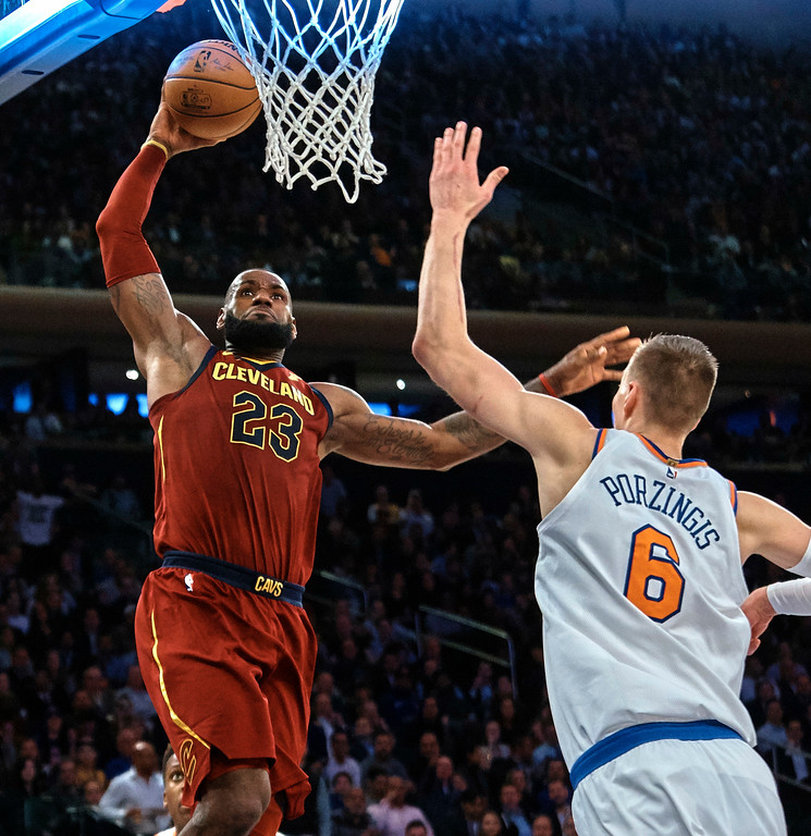. Cleveland Cavaliers\' LeBron James, left, drives to the basket against New York Knicks\' Kristaps Porzingis (6) during the first half of a NBA basketball game at Madison Square Garden in New York, Monday, Nov. 13, 2017. (AP Photo/Andres Kudacki)