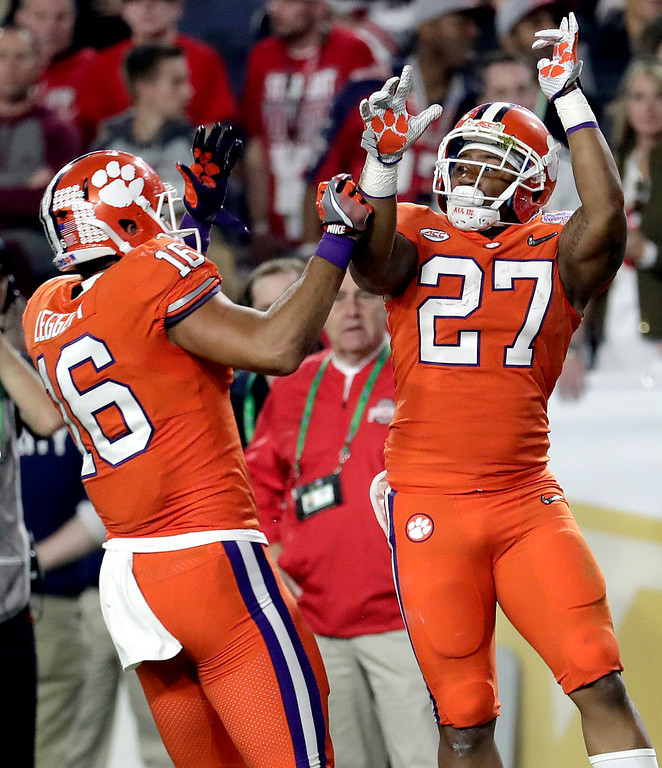 . Clemson running back C.J. Fuller (27) celebrates his touchdown against Ohio State during the first half of the Fiesta Bowl NCAA college football game, Saturday, Dec. 31, 2016, in Glendale, Ariz. (AP Photo/Rick Scuteri)