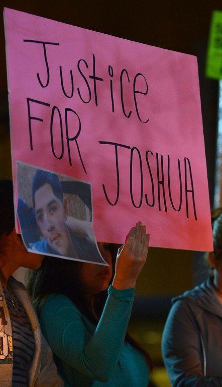 . Friends, family and supporters came out in folds Monday night to hold a candlelight vigil at the San Bernardino County Sheriff�s Highland station in protest to the Jan. 18 shooting of 16-year-old Joshua Alvarez by deputies. LaFonzo Carter/Staff Photographer