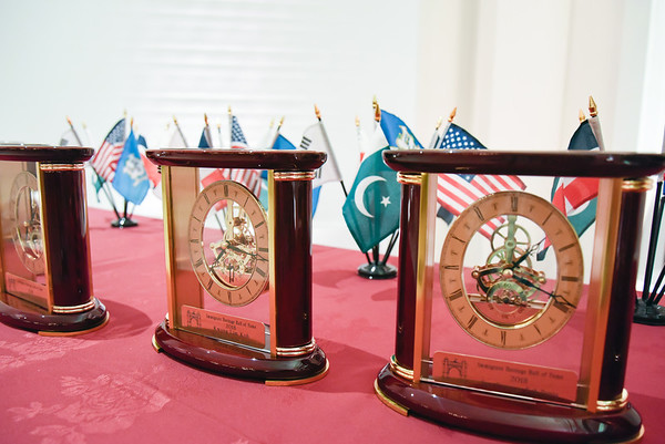 09/27/18 Wesley Bunnell | Staff The Immigrant Heritage Hall of Fame 2018 Gala and Induction Ceremonies was held on Thursday night at The Aqua Turf Club. Awards sit on a side table prior to presentation.