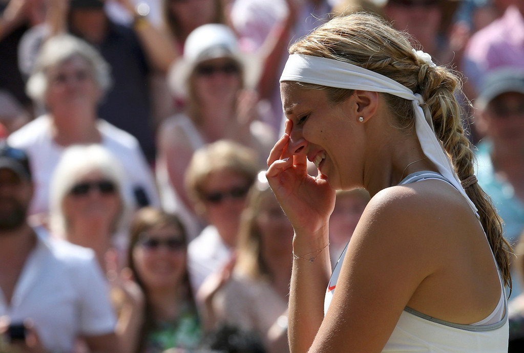 . Sabine Lisicki of Germany cries as she is interviewed on Centre Court after being defeated by Marion Bartoli of France in their women\'s singles final tennis match at the Wimbledon Tennis Championships, in London July 6, 2013.         REUTERS/Suzanne Plunkett