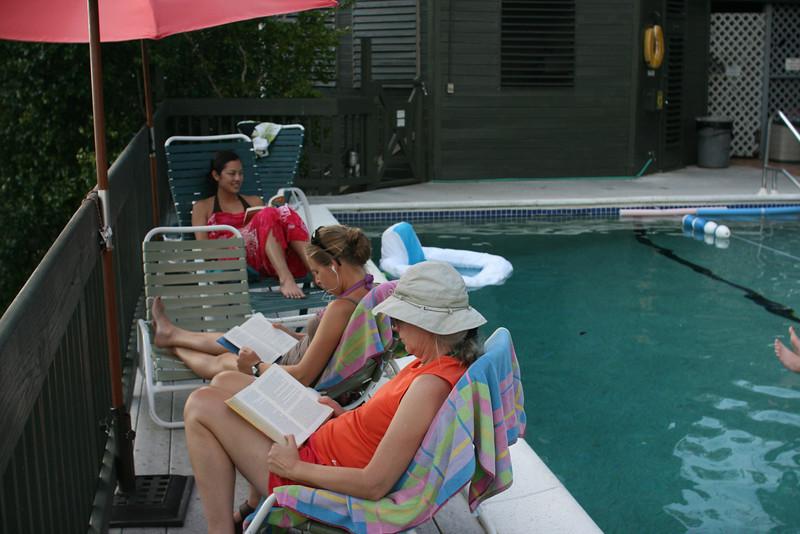 Jayna, Kjirsten & Mitzi reading by the pool.