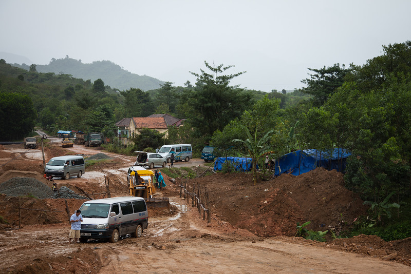 After flying into Nha Trang we took a taxi to Dalat. A typhoon was hitting Vietnam that morning, so the rain was quite heavy. Our driver, for whatever reason, took the long back way (as I later confirmed with my GPS track) to Dalat. Along the way, we came to this road and bridge that had essentially been washed out by the rain. This bulldozer attempted to clear enough dry soil to let the stuck vehicles pass, but it didn't do much good. We turned around and backtracked a few hours to go another route to Dalat.