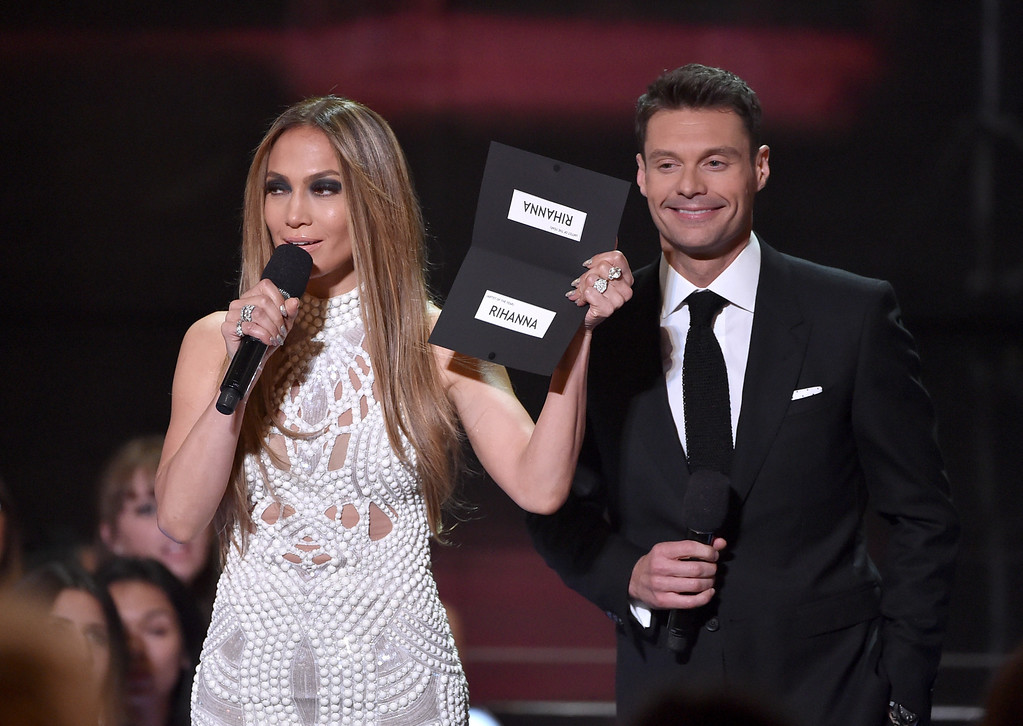 . LOS ANGELES, CA - MAY 01:  Singer Jennifer Lopez (L) and TV personality Ryan Seacrest speak onstage during the 2014 iHeartRadio Music Awards held at The Shrine Auditorium on May 1, 2014 in Los Angeles, California. iHeartRadio Music Awards are being broadcast live on NBC.  (Photo by Kevin Winter/Getty Images for Clear Channel)