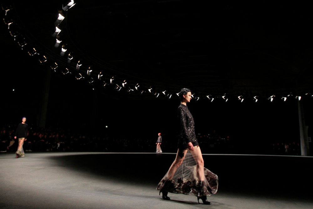 Description of . A model presents a creation by Italian designer Riccardo Tisci for Givenchy as part of his Fall-Winter 2013/2014 women's ready-to-wear fashion collection during Paris fashion week on March 3, 2013.  REUTERS/Gonzalo Fuentes