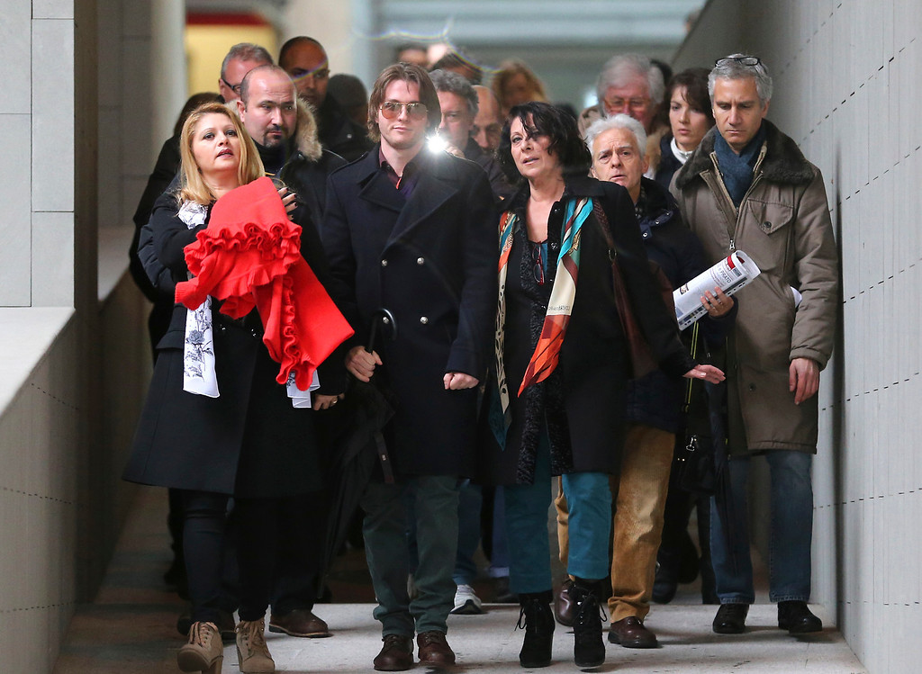 . Raffaele Sollecito is flanked by his stepmother Mara Papagni, left, and his aunt Sara Achille, right, as he leaves after attending the final hearing before the third court verdict for the murder of British student Meredith Kercher, in Florence, Italy, Thursday, Jan. 30, 2014. The first two trials produced flip-flop verdicts of guilty then innocent for Kercher former roommate, American student Amanda Knox, who is not attending the hearing,  and her former Italian boyfriend, Raffaele Sollecito, and the case has produced harshly clashing versions of events. A Florence appeals panel designated by Italy\'s supreme court to address issues it raised about the acquittal is set to deliberate Thursday, with a verdict expected later in the day. (AP Photo/Antonio Calanni)