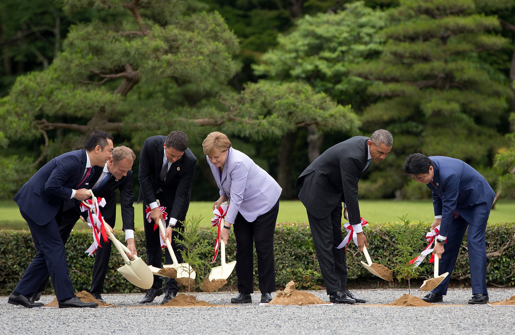 . Mie Prefecture Gov. Eikei Suzuki, left, joins leaders of Group of Seven industrial nations, from second left, European Council President Donald Tusk, Italian Prime Minister Matteo Renzi, German Chancellor Angela Merkel, U.S. President Barack Obama and Japanese Prime Minister Shinzo Abe as they participate in a tree planting ceremony during their visit to the Ise Jingu shrine in Ise, Mie Prefecture, Japan, Thursday, May 26, 2016, as part of the G-7 Summit. (AP Photo/Carolyn Kaster, Pool)