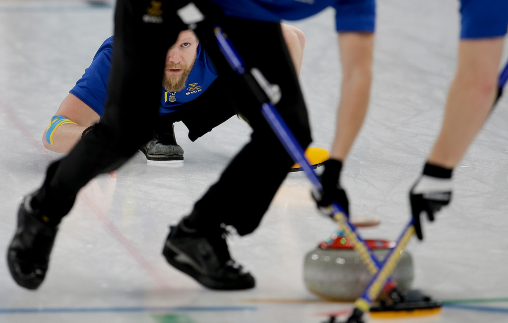 . Sweden\'s skip Niklas Edin watches his teammates sweep the ice during the men\'s final curling match against THE United States at the 2018 Winter Olympics in Gangneung, South Korea, Saturday, Feb. 24, 2018. (AP Photo/Natacha Pisarenko)