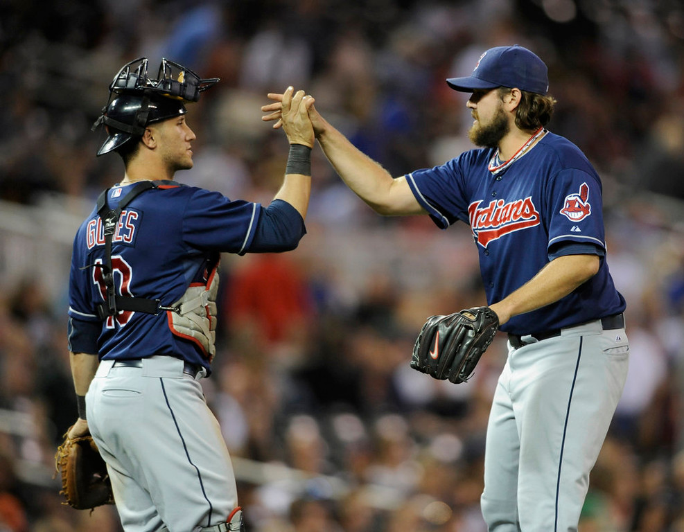 . Cleveland catcher Yan Gomes and closer Chris Perez celebrates their team\'s victory over the Twins. (Photo by Hannah Foslien/Getty Images)
