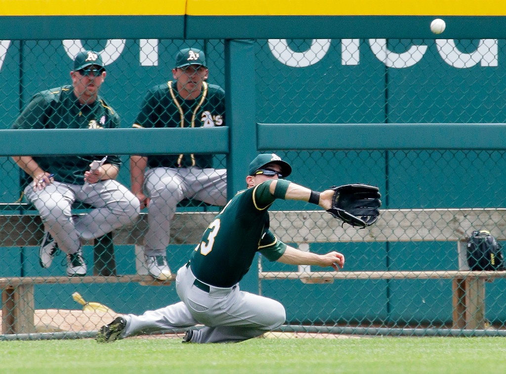 . Oakland Athletics left fielder Sam Fuld makes a sliding catch of a fly ball hit by Detroit Tigers\' J.D. Martinez during the second inning of a baseball game at Comerica Park, Thursday, June 4, 2015, in Detroit. (AP Photo/Duane Burleson)